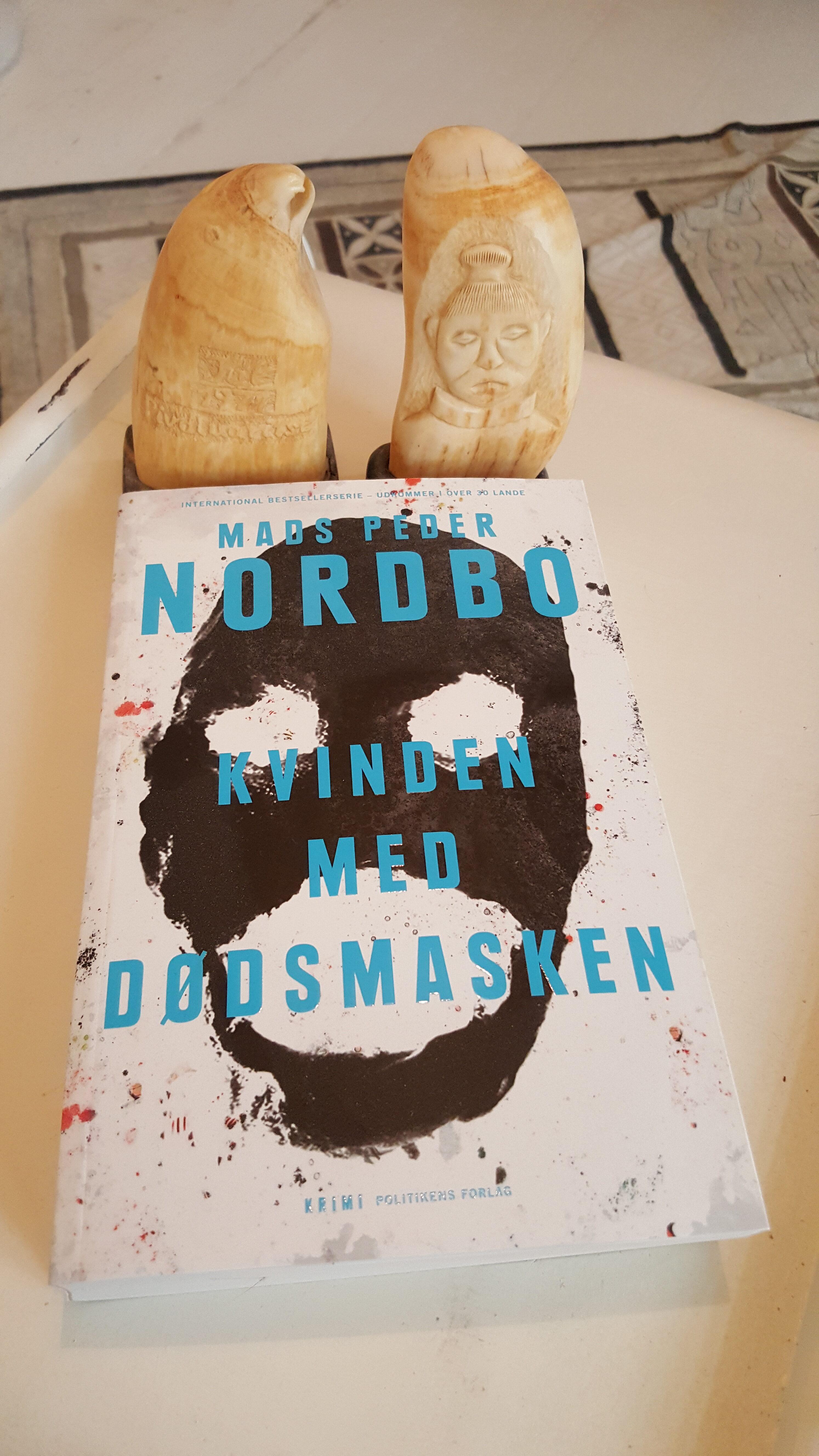 Kvinden med dødsmasken af Mads Peder Nordbo